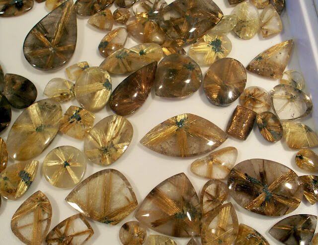 "Rutilated Quartz -  is usually a colorless tranparent variety of Quartz, filled with Rutile inclusions that form as straw-like needles of reddish, golden, or silvery strands often referred to as ""Angel Hair"",
