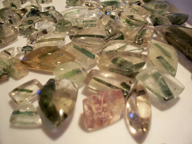 Tourmalinated Quartz  is usually clear quartz included with needles of Tourmaline