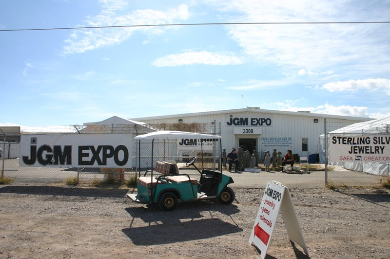Setting up in the back of the JG&M Expo on Simpson Street in Tucson. Many dealers pack into the back lot of this well-known show each year selling thousands of tons of rough stone from all over the world. Inside the building are dozens of dealers of fine jewelry and gemstones.