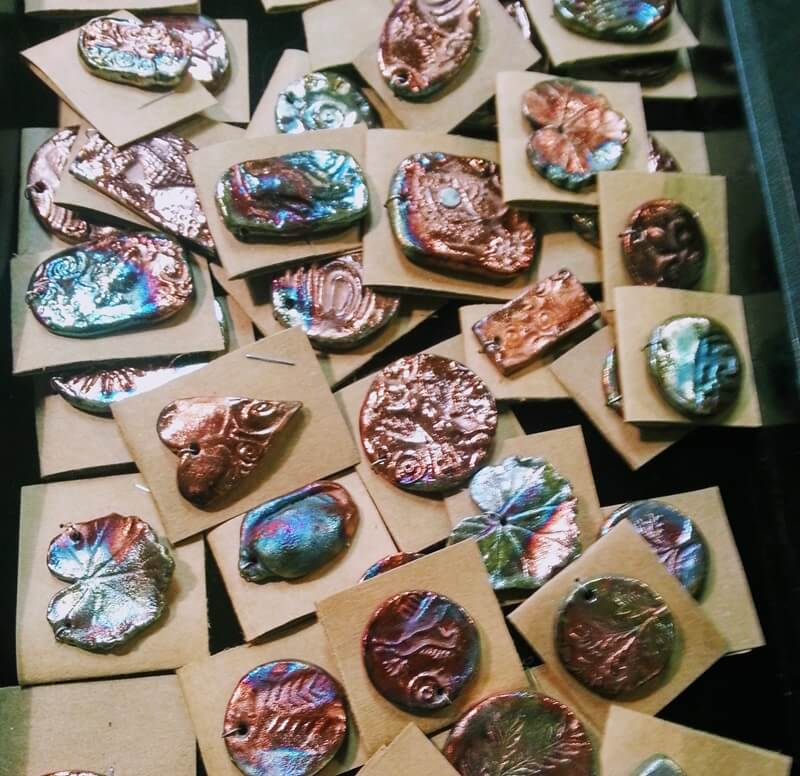 Shimmering handcrafted Raku charms at the Bead Renaissance Show at the Denver Mart/Plaza