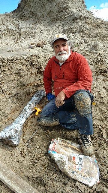 Tom with a large dino bone he just dug.