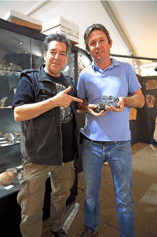 Meteorite Man Geoff Notkin and his friend Adam Aaronson of Sahara Overland show off a beautiful Moroccan iron meteorite.// Credit: David J. Eicher